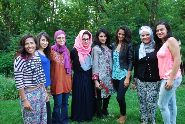 Kiran (fifth from the left) poses with fellow female Muslim athletes gathered for a ride in America by Team Shirzanan